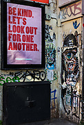 COVID support poster, Be kind. Lets look out for one another, in Brick Lane during the coronavirus pandemic on the 24th April 2020 in London, United Kingdom. Originally designed for London, the Community is Kindness campaign has now spread outside the capital to ease fears about the coronavirus pandemic.