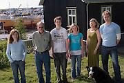 ICE.MWdrv04.16.xrw..Björn Thoroddsen and his wife Margret (Linda) Gunnlaugsdottir and their children outside their house in Hafnarfjördur, Iceland, near Reykjavik. The family is standing in the same order as they did for the family portrait for Material World in December 1993. Left to right: Sif Hauksdottir, 28; Björn Thoroddsen, 57; Gestur Björnsson, 21; Thordis Björnsdottir, 17; Margret (Linda) Gunnlaugsdottir, 52; and Gunnlaugur Bjornsson, 23. .Ten years ago the Thoroddsens were the Icelandic participants in Material World: A Global Family Portrait, 1994 (pages 162-163) for which they took all of their possessions out of their house for a family and possessions portrait in the snow. {{Central image from original book project is: ICE.mw.01.xxs.}}.