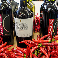 Red chilly peppers and bottles of Wine are seen at  the Biennale del Gusto on October 28, 2013 in Venice, Italy. The Biennale del Gusto is an exhibition held over four days, dedicated to traditional food and drinks from all regions of Italy.