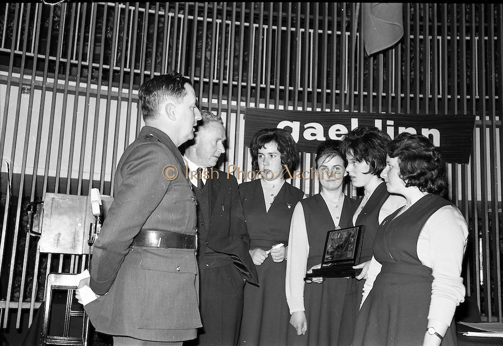 30/03/1963<br /> 03/30/1963<br /> 30 March 1963<br /> Gael - Linn Annual Debating Competition  for Secondary Schools awards presented at the Shelbourne Hotel, Dublin. Pictured (l-r) are: Col. Eoin O'Neill, Head of the Command and Staff School, Curragh, who was Chairman of the Adjudicators and Proinnsias Mac a'Bheatha (Stiurthoir Inniu) chatting with the winning team from Colaiste Mhuire, Tourmakeady, Co. Mayo at the final of the Annual Gael Linn Secondary Schools Debating Competition. The Team are: Maire Ni Lafaigh, (Captain); Maire Ni Fhlaithearta; Maire Ni Nuaidhain and Imelda Ni Mhaille.