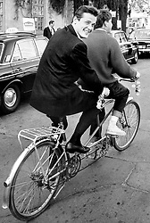 File photo dated 02/06/65 of Roger Moore taking a ride on the back of a tandum bycycle through the streets of Stockholm, Sweden. Sir Roger has died in Switzerland after a short battle with cancer, his family has announced.