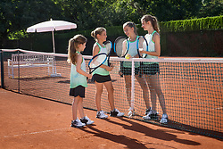 Girls playing tennis on a sunny day, Bavaria, Germany