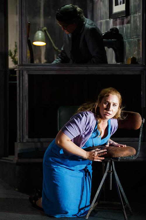 "LONDON, UK, 21 June, 2016. Laura Wilde (as Jenufa, bottom) and Valerie Reid (as Grandmother Buryja, top) rehearse for the revival of director David Alden's production of Janacek's opera ""Jenufa"" at the London Coliseum for the English National Opera. The production opens on 23 June. Photo credit: Scott Rylander."