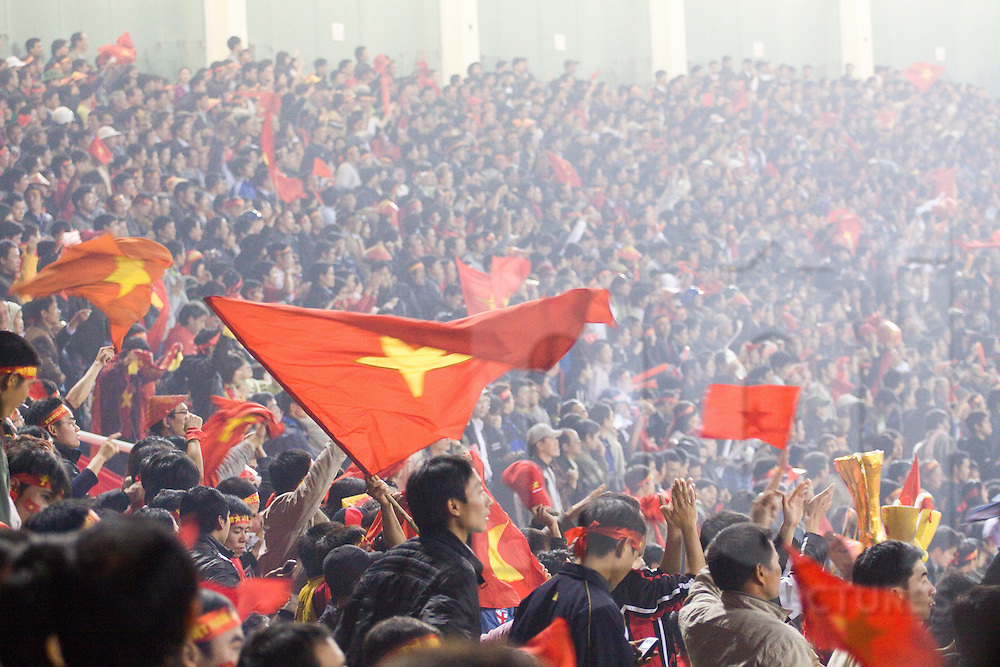 A large crowd gather to support national soccer team during a game, My Dinh Stadium, Hanoi, Vietnam, Southeast Asia