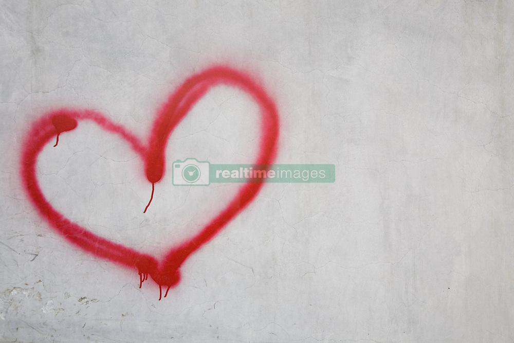 Dec. 04, 2012 - Red heart shape on white wall (Credit Image: © Image Source/ZUMAPRESS.com)