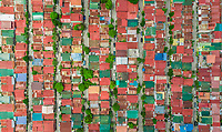 Aerial view of colourful roofs of residential district, Imus, Philippines.