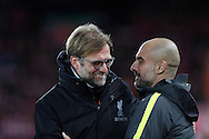 Jurgen Klopp manager of Liverpool greets Manchester City Manager Pep Guardiola during the English Premier League match at Anfield Stadium, Liverpool. Picture date: December 31st, 2016. Photo credit should read: Lynne Cameron/Sportimage
