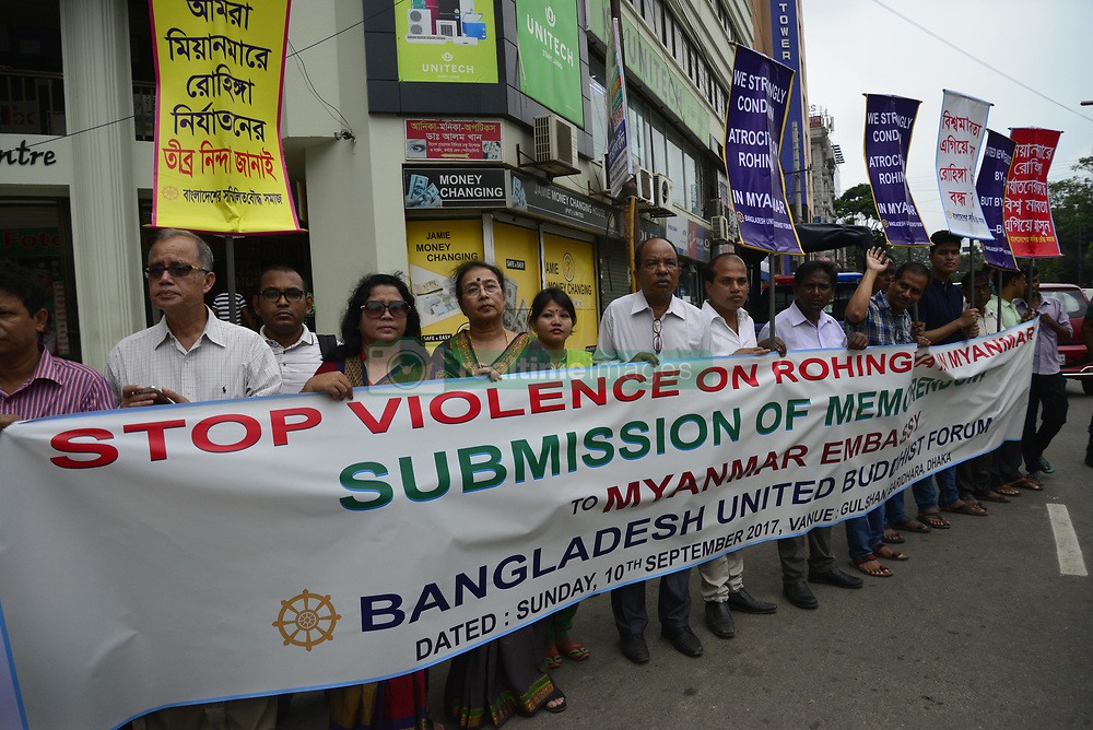 September 10, 2017 - Dhaka, Bangladesh - Bangladesh United Buddhist Forum activist hold up Placard during protest rally demanding stop violence on Rohingya in Myanmar near Myanmar Embassy in Dhaka, Bangladesh, on September 10, 2017. Tens of thousands more people have crossed by boat and on foot into Bangladesh in the last two weeks as they flee violence in western Myanmar. (Credit Image: © Str/NurPhoto via ZUMA Press)