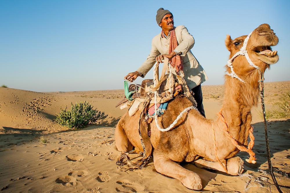 Man and camel in Jaisalmer's desert