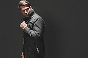 BIRMINGHAM, AL – DECEMBER 19, 2014: A caucasian male modeling fashionable men's outerwear.