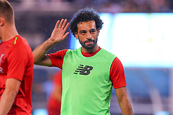 July 25, 2018 - East Rutherford, NJ, U.S. - EAST RUTHERFORD, NJ - JULY 25:  Liverpool midfielder Mohamed Salah (11) waves to the fans as he warms up during halftime of the International Champions Cup Soccer game between Liverpool and Manchester City on July 25, 2018 at Met Life Stadium in East Rutherford, NJ.  (Photo by Rich Graessle/Icon Sportswire) (Credit Image: © Rich Graessle/Icon SMI via ZUMA Press)