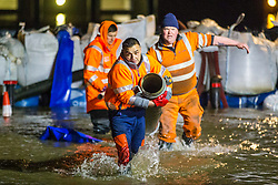 © Licensed to London News Pictures. 22/01/2021. York UK. Workmen battle through the flood water to try and prevent properties flooding further in York. The river ouse in York has continued to rise over night & is now at a height 4.62m with it expected to peak later on today as Storm Christoph continues to affect the UK. Photo credit: Andrew McCaren/LNP