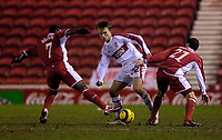 Photo: Jed Wee.<br /> Middlesbrough v Stuttgart. UEFA Cup. 23/02/2006.<br /> <br /> Stuttgart's Jesper Gronkjaer (C), formerly of Chelsea and Birmingham, tries to get between Middlesbrough defenders George Boateng (L) and Stuart Parnaby.