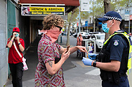 MELBOURNE, VIC - SEPTEMBER 20: Police question Footscray locals after learning protester's had planned to appear in the market during a series of pop up Freedom protests on September 20, 2020 in Melbourne, Australia. Freedom protests are being held in Melbourne every Saturday and Sunday in response to the governments COVID-19 restrictions and continuing removal of liberties despite new cases being on the decline. Victoria recorded a further 14 new cases overnight along with 7 deaths. (Photo by Dave Hewison/Speed Media)