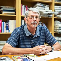 """John Taylor, local Gallup author of """"Navajo Scouts During the Apache Wars"""" poses for a portrait Wednesday, Sept. 4 in Gallup. Taylor will be at the Octavia Fellin Public Library Tuesday, Sept. 10 for a book signing."""