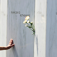 A visitor to the Wall of Names at the Flight 93 National Memorial reaches out to touch the name of Mark David Rothenberg on the 15th anniversary of  the the crash of the Flight 93 on September 11, 2016.  Photo by Archie Carpenter/UPI