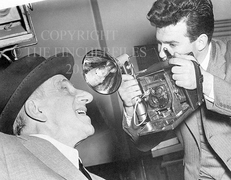 British photographer with American singer and comedian Jimmy Durante, also known as the Great Schnozzola.
