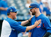 Kansas City Royals manager Ned Yost, left, jokes with Chicago Cubs pitcher Jon Lester, right, before a baseball game at Kauffman Stadium in Kansas City, Mo., Tuesday, Aug. 7, 2018. (AP Photo/Colin E. Braley)