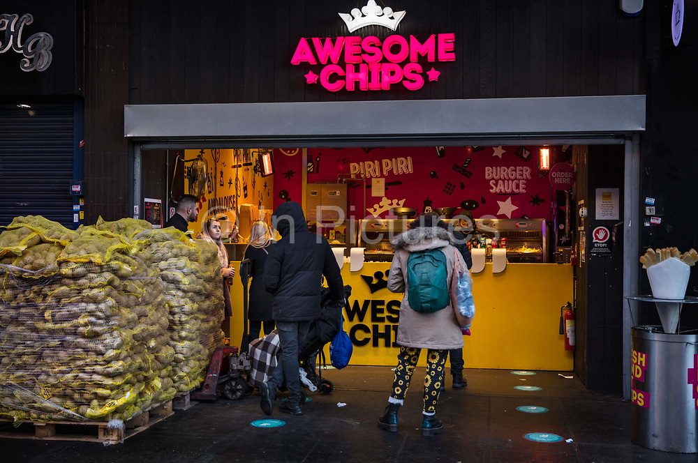 Take away chip shop in Wood Green Shopping Centre during the second national coronavirus lockdown on 19th November 2020 in London, United Kingdom. The new national lockdown is a huge blow to the economy and for individuals who were already struggling, as Covid-19 restrictions are put in place until 2nd December across England, with all non-essential businesses closed.
