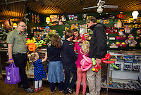 Brian Healey, Isabelle Bird, Julia Healey, Mateu Parera, Suzanne Healey-Parera and Mark Healey check out at the prize counter with Dajana Kovacovicova at the Half Moon Arcades on Wednesday afternoon.  (Karen Bobotas/for the Laconia Daily Sun)