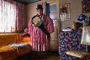 María Eugenia Mamani Herrera alias Claudina La Maldita inside her home showing her belt of National Champion of Bolivian Association Catchascan 2012, in La Paz, Bolivia, February 26, 2012.