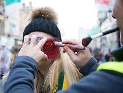 A Wales fans has face paint applied<br /> <br /> Photographer Simon King/Replay Images<br /> <br /> Under Armour Series - Wales v Australia - Saturday 10th November 2018 - Principality Stadium - Cardiff<br /> <br /> World Copyright © Replay Images . All rights reserved. info@replayimages.co.uk - http://replayimages.co.uk