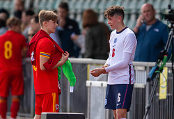 NEWPORT, WALES - Friday, September 3, 2021: Wales' Iwan Roberts (L) and England's Luke Chambers chat after an International Friendly Challenge match between Wales Under-18's and England Under-18's at Spytty Park. (Pic by David Rawcliffe/Propaganda)