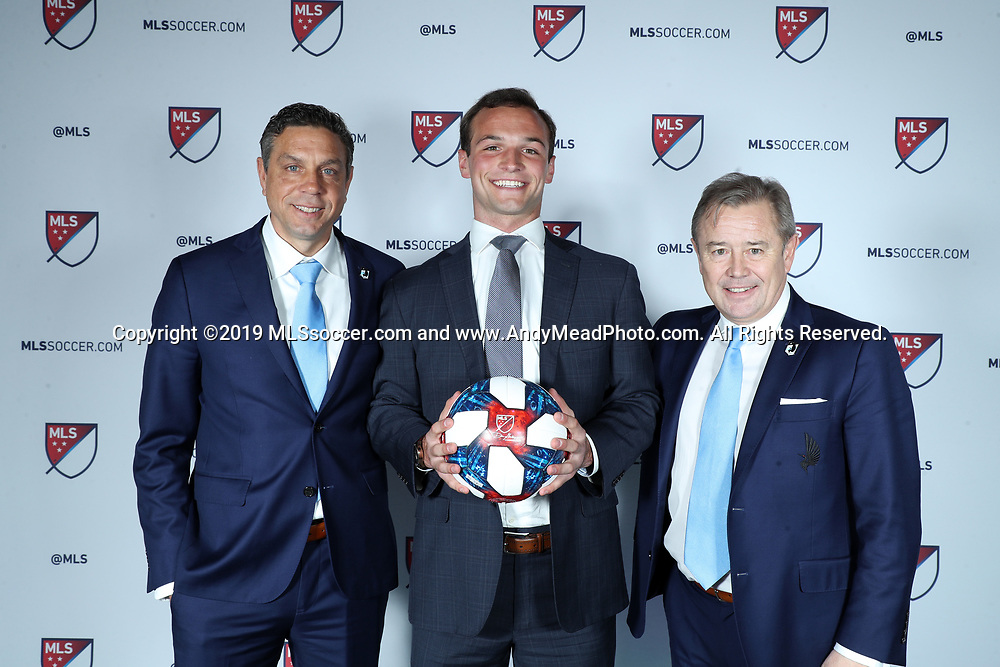 CHICAGO, IL - JANUARY 11: Chase Gasper was taken with the fifteenth overall pick by Minnesota United FC. With sporting director Manny Lagos (left) and head coach Adrian Heath (right). The MLS SuperDraft 2019 presented by adidas was held on January 11, 2019 at McCormick Place in Chicago, IL.
