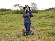 Laos is the most bombed country, per capita, in the world with more than 270 million cluster bomb submunitions dropped on it during the Vietnam War from 1963 to 1974. The Mines Advisory Group (MAG) are a humanitarian organisation clearing the remnants of conflict worldwide and have been working in Lao PDR since 1994. UXO clearance team 6 (UCT6) is an all-female team, one of MAG's seven UXO clearance teams in Xieng Khouang Province, one of the most heavily bombed provinces in Lao PDR. Portrait of UCT6 technician, Champathong Khampanisong (26) on the clearance site in Ban Namoune.