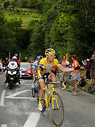 Thomas Voeckler wonders who his yellow jersey will go to as he loses time on the Alp D'Huez stage 19 of the 2011 Tour de France