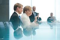 21 JUL 2010, BERLIN/GERMANY:<br /> Ulrich Wilhelm (L), Regierungssprecher, Angela Merkel (R), CDU, Bundeskanzlerin, Pressekonferenz vor der Sommerpause, Bundespressekonferenz<br /> IMAGE: 20100721-02-022<br /> KEYWORDS: Kamera, Camera