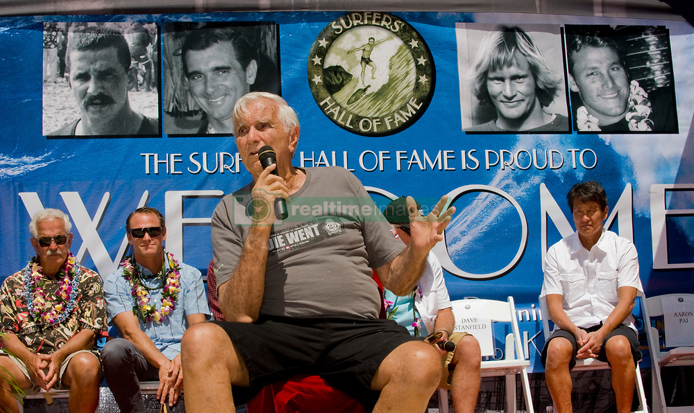 March 6, 2018 - FILE - Big-wave pioneer, surf innovator, mentor and historian George Downing has passed away at 87. Born and raised in Honolulu, Downing surfed Hawaii in the '40s on finless Hot Curls made out of redwood. He was a surfer responsible for many firsts in the sport, and in 1950 he produced the first surfboard with a removable fin. Eight years later he and a handful of other surfers rode 30 foot waves at Makaha, pushing the boundaries of what was believed to be possible at the time. Pictured: Aug. 05, 2011 - Huntington Beach, California, U.S. - GEORGE DOWNING talks about his life as a surfer during his induction into the 2011 Surfers Hall of Fame in front of Huntington Surf & Sport..(Credit Image: © Mark Rightmire/The Orange County Register/ZUMAPRESS.com)