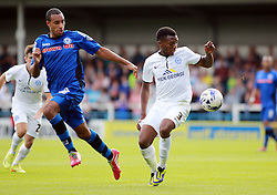 Peterborough United's Kgosi Ntlhe in action with Rochdale's Rhys Bennett - Photo mandatory by-line: Joe Dent/JMP - Mobile: 07966 386802 09/08/2014 - SPORT - FOOTBALL - Rochdale - Spotland Stadium - Rochdale AFC v Peterborough United - Sky Bet League One - First game of the season
