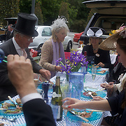 Race goers enjoy lunch in the car park before the race meeting at Royal Ascot Race Course. Royal Ascot is one of the most famous race meetings in the world, frequented by Royalty and punters from the high end of society to the normal everyday working class. Royal Ascot 2009, Ascot, UK, on Thursday, June 18, 2009. Photo Tim Clayton.