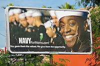 Tattered Navy recruitment billboard in Laredo, Texas appealing to mothers.