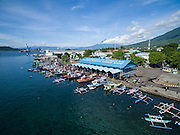 Aerial view of Bitung City Fish Market where members of Papusungan village enterprise groups purchase their fish.  Their womens group purchases fish to smoke and resell as part of a added value chain and zero waste income project.  The villagers have benefited from enterprise groups, new boats, fishing equiptment, marine protected areas and ecotourism projects supported by the Indonesia Government and IFAD through the Coastal Community Development Project.