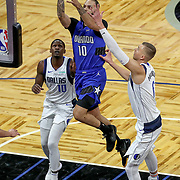 ORLANDO, FL - MARCH 01: Evan Fournier #10 of the Orlando Magic attempts a shot past Kristaps Porzingis #6 of the Dallas Mavericks and Dorian Finney-Smith #10 of the Dallas Mavericks during the first half at Amway Center on March 1, 2021 in Orlando, Florida. NOTE TO USER: User expressly acknowledges and agrees that, by downloading and or using this photograph, User is consenting to the terms and conditions of the Getty Images License Agreement. (Photo by Alex Menendez/Getty Images)*** Local Caption *** Evan Fournier; Kristaps Porzingis; Dorian Finney-Smith