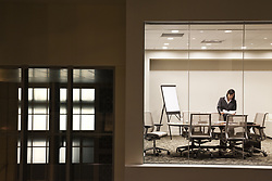 October 19, 2010 - A view looking into a conference room at night of an Asian businesswoman. (Credit Image: © Mint Images via ZUMA Wire)
