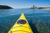 The bow of a sea kayak on the water near Turn Island in the San Juan Islands of Washington State, USA.