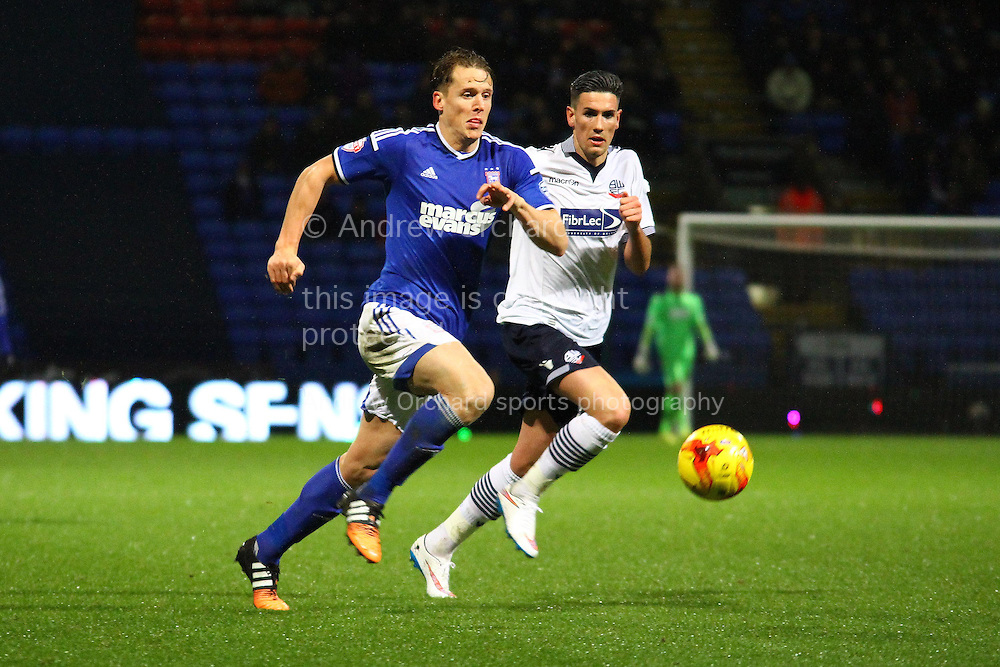 Christophe Berra of Ipswich Town gets in fromt of Conor Wilkinson of Bolton Wanderers. Skybet football league championship match, Bolton Wanderers v Ipswich Town at the Macron stadium in Bolton, Lancs on Saturday 13th December 2014.<br /> pic by Chris Stading, Andrew Orchard sports photography.