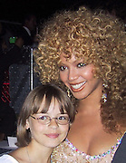 """Beyonce Knowles with a fan.EXCLUSIVE.""""Austin Powers"""" Post Premiere Party.Universal Studios.Hollywood, CA.July 22, 2002.Photo By Celebrityvibe.com.."""