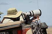 Tanzania, Serengeti National Park, Nature tourists photographing wildlife