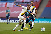 Oxford United defender Sam Long (12) tussles with Wycombe Wanderers midfielder Fred Onyedinma (23) during the EFL Sky Bet League 1 Play Off Final match between Oxford United and Wycombe Wanderers at Wembley Stadium, London, England on 13 July 2020.