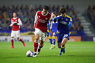 w29\ battles for possession with Arsenal defender William Saliba (4) during the EFL Trophy match between AFC Wimbledon and U21 Arsenal at Plough Lane, London, United Kingdom on 8 December 2020.