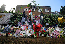 © Licensed to London News Pictures. 28/12/2016. London, UK. Tributes are left at the door of George Michael's London home in Highgate, North London. Pop superstar George Michael died on Christmas day at his Oxfordshire home on the River Thames aged 53. Photo credit: Ben Cawthra/LNP