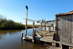 04 March 2016. Isle de Jean Charles, Louisiana.<br /> Vanishing land. First climate refugees in the USA. Isle de Jean Charles Band of Biloxi-Chitimacha Indians.<br /> Scenes from the disappearing bayou where the tribe has recently been awarded $52 million to resettle on higher ground as more and more of their land is consumed by erosion from the Gulf of Mexico.<br /> Photo©; Charlie Varley/varleypix.com