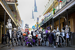 09 February 2016. New Orleans, Louisiana.<br /> Mardi Gras Day. Walking with Skeletons. The Skeleton Krewe pose for a group photo in the French Quarter. The Krewe meets before sunrise and walks 5 miles from Uptown, making their way along St Charles Avenue and into the French Quarter where they celebrate Mardi Gras Day.<br /> Photo©; Charlie Varley/varleypix.com