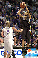 Missouri guard LaToya Bond (R) shoots and scores over Kansas State's Shalee Lehning (L) in the first half.  LaToya Bond finished with 21 points, as Missouri beat K-State 66-65 in overtime at Bramlage Coliseum in Manhattan, Kansas, February 1, 2006.