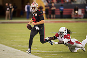 San Francisco 49ers quarterback Blaine Gabbert (2) runs out of bounds to avoid a Arizona Cardinals tackle at Levi's Stadium in Santa Clara, Calif., on October 6, 2016. (Stan Olszewski/Special to S.F. Examiner)