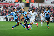Jefferson Montero of Swansea city looks to go past Dele Alli (l) and Kyle Walker © of Tottenham. Barclays premier league match, Swansea city v Tottenham Hotspur at the Liberty Stadium in Swansea, South Wales on Sunday 4th October 2015.<br /> pic by  Andrew Orchard, Andrew Orchard sports photography.